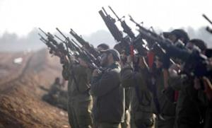Israeli soldiers prepare weapons in a deployment area on Israel's border with the Gaza Strip on Nov. 19.