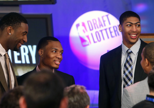 NBA basketball players, from left, Detroit Pistons' Andre Drummond, Portland Trailblazers' Damian Lillard and New Orleans Pelicans' Anthony Davis mingle onstage before the NBA basketball draft lottery