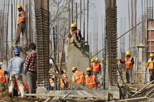 Labourers work at the construction site of an educational institute in Gujarat