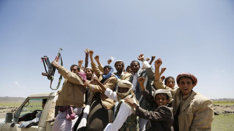 Followers of the Shi'ite Houthi group ride on a truck at a gathering near the Yemeni capital Sanaa