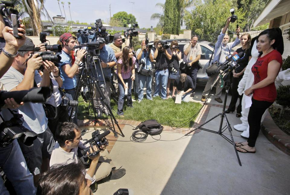 FILE - This May 19, 2010 file photo shows Octomom, Nadya Suleman speaking to media outside her home in La Habra, Calif. Suleman has filied for bankruptcy  and her home is scheduled to be auctioned on Monday,  May 7, 2012.  (AP Photo/Damian Dovarganes, File)