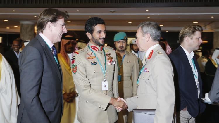 Commander of Bahrain's Royal Guard Colonial Sheikh Nasser bin Hamad al-Khalifa meets Britian's Secretary of State for Defence Philip Hammond at the IISS Regional Security Summit - The Manama Dialogue in Manama