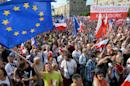Supporters of the Committee for the Defense of Democracy (KOD) movement demonstrate in Warsaw on June 4, 2016