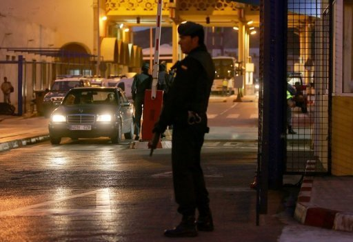 Spanish security forces broke up an Al-Qaeda linked network and arrested eight suspects in raids early Friday morning in Ceuta, a Spanish enclave in north Africa, the government said. File picture shows a Spanish policeman at the Tarajal border checkpoint, in Ceuta