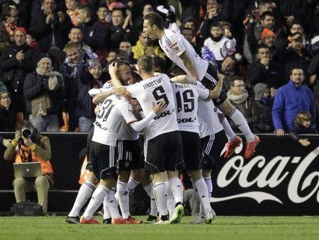 Valencia's players celebrate after they scored against Sevilla during their Spanish first division soccer match in Valencia