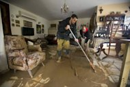 <p>Family members sweep murky water from their flooded house in Beit Hefer on January 9, 2013. The worst storms in a decade left swathes of Israel and Jordan under a blanket of snow and parts of Lebanon blacked out on Thursday, bringing misery to a region accustomed to temperate climates.</p>