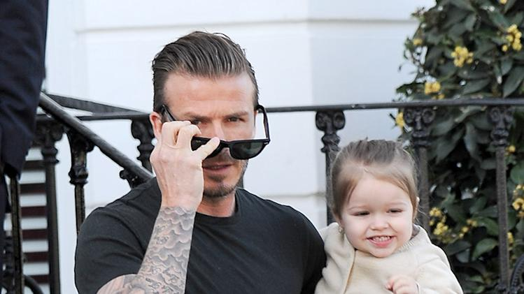 David and Harper Beckham are seen out in Kensington, UK