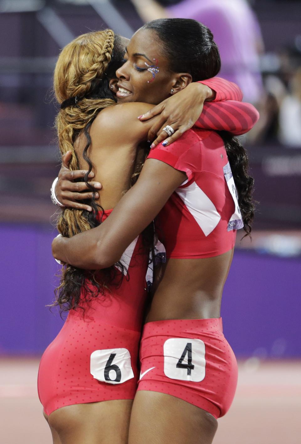 United States' Sanya Richards-Ross, left, is embraced by United States' Deedee Trotter after she won gold in the women's 400-meter final during the athletics in the Olympic Stadium at the 2012 Summer Olympics, London, Sunday, Aug. 5, 2012. (AP Photo/David J. Phillip)