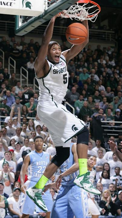 Michigan State's Adreian Payne dunks during the first half of an NCAA college basketball game against North Carolina, Wednesday, Dec. 4, 2013, in East Lansing, Mich. North Carolina won 79-65