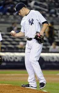 New York Yankees pitcher David Phelps reacts during the 12th inning of a baseball game against the Arizona Diamondbacks Thursday, April 18, 2013, at Yankee Stadium in New York. The Diamondbacks won 6-2. (AP Photo/Bill Kostroun)