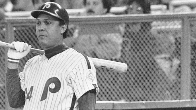 FILE - In this Oct.. 14, 1983 file photo, Philadelphia Phillies batter Tony Perez, left, stands on-deck as teammate Pete Rose watches from the dugout during Game 3 of baseball's World Seires against the Baltimore Orioles in Philadelphia, Pa. Rose was benched for the game by manager Paul Owens and Perez was picked to start in his place. (AP Photo/File)