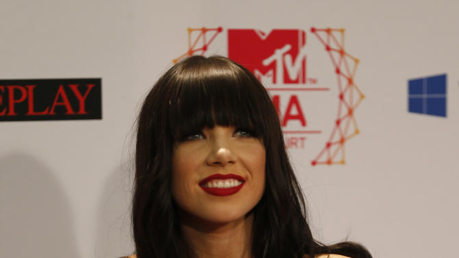 Canadian singer Carly Rae Jepsen shows off her both awards during the 2012 MTV European Music Awards show at the Festhalle in Frankfurt, central Germany, Sunday, Nov. 11, 2012. (AP Photo/Frank Augstein)