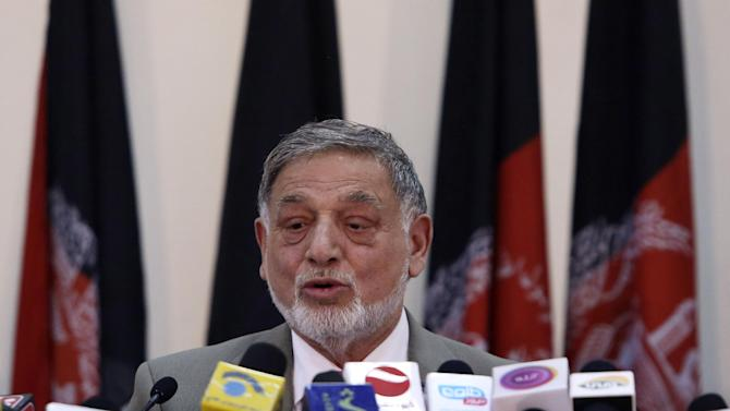 Ahmad Yousuf Nouristani, chairman of the Independent Election Commission, speaks during a press conference in Kabul, Afghanistan, Sunday, April 13, 2014. Partial results released Sunday in Afghanistan's crucial presidential election show a tight race between ex-foreign minister Abdullah Abdullah, with 41.9 percent of the vote, and former finance minister Ashraf Ghani, with 37.6 percent. (AP Photo/Rahmat Gul)