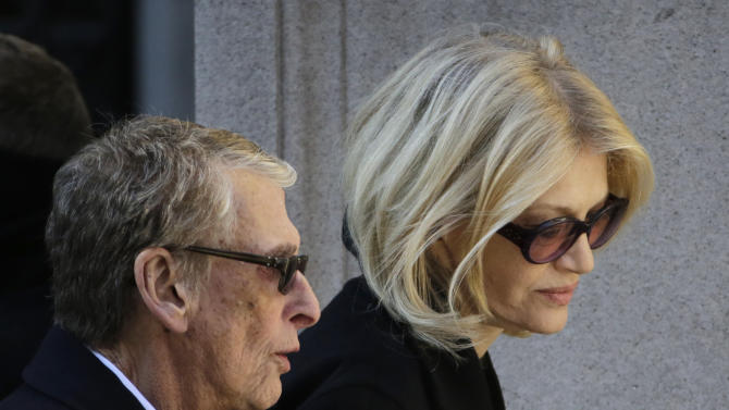 """FILE - In this Feb. 7, 2014, file photo, director Mike Nichols, left, and Diane Sawyer arrive for the funeral of actor Philip Seymour Hoffman at the Church of St. Ignatius Loyola in New York. Nichols, the director of matchless versatility who brought fierce wit, caustic social commentary and wicked absurdity to such film, TV and stage hits as """"The Graduate,"""" `'Angels in America"""" and """"Monty Python's Spamalot,"""" died Thursday, Nov. 20, 2014. He was 83.  (AP Photo/Mark Lennihan, File)"""