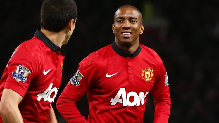 Manchester United's Ashley Young celebrates with team mate Javier Hernandez after scoring a goal against West Ham during their English Premier League soccer match in Manchester