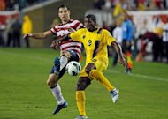Carlos Bocanegra (L) of the US and Mikele Leigertwood of Antigua and Barbuda during their 2014 World Cup qualifying match on June 8. Bocanegra was on hand to score after goalkeeper Molvin James parried a Herculez Gomez header