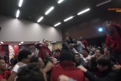 USC players erupt in cheers after being told interim coach Clay Helton was hired