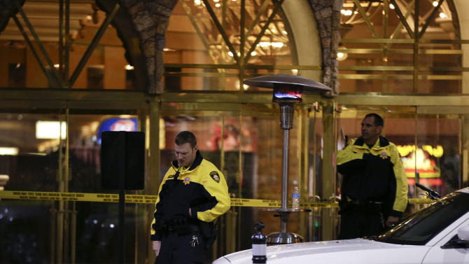 Las Vegas Metro Police officers stand watch outside the entrance to the Excalibur hotel-casino after a shooting near the registration desk left two dead, Friday, Dec. 14, 2012, in Las Vegas. At around 8:30 p.m., a man shot a woman, who was a vendor at the hotel's concierge desk, and then turned the gun on himself. The man was found dead at the scene. The woman was transported to a local hospital, where she was pronounced dead.(AP Photo/Julie Jacobson)