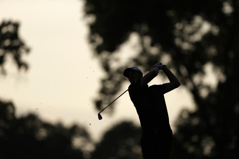 Justin Rose, of England, hits down the 18th fairway during the third round of the U.S. Open golf tournament at Merion Golf Club, Saturday, June 15, 2013, in Ardmore, Pa. (AP Photo/Darron Cummings)