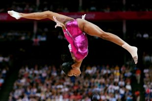 Gabby Douglas dominates on the balance beam, Thursday, Aug. 2. (Photo: Getty Images/Streeter Lecka)