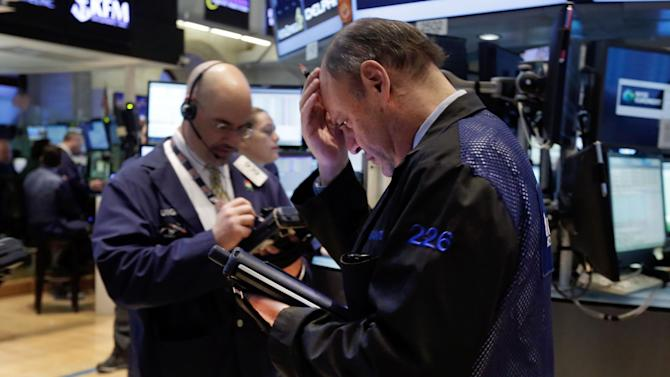 Trader Randy Beller, right, works on the floor of the New York Stock Exchange, Monday, April 7, 2014. Stocks are starting out the week the same way they ended the last one, down. (AP Photo/Richard Drew)