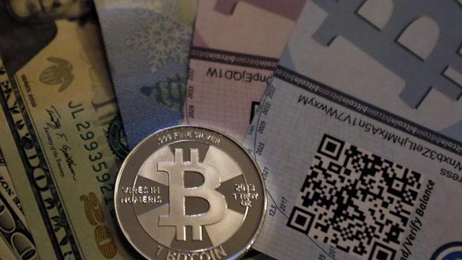 One of Bitcoin enthusiast Mike Caldwell's coins in this photo illustration at his office in Sandy, Utah
