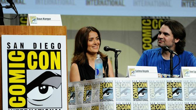 """Salma Hayek, left, and director Joe Lynch attend the RADiUS-TWC """"Everly"""" panel on Day 2 of Comic-Con International on Friday, July 25, 2014, in San Diego. (Photo by Chris Pizzello/Invision/AP)"""