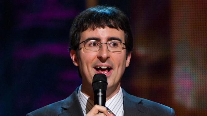 FILE - In this Oct. 2, 2010 file photo, John Oliver appears on stage at Comedy Central's 'Night Of Too Many Stars: An Overbooked Concert For Autism Education' at the Beacon Theatre in New York. HBO says that John Oliver is getting his own weekly show after his winning turn as substitute host for Jon Stewart. Next year, Oliver's Sunday night program will take a satirical look at current events for the week, HBO said Thursday, Nov. 14, 2013. (AP Photo/Charles Sykes)