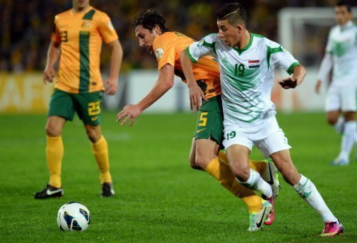Australia's Rhys Williams (C) vies for the ball with Iraq's Dhurgham Ismael Dawoodi in Sydney on June 18, 2013