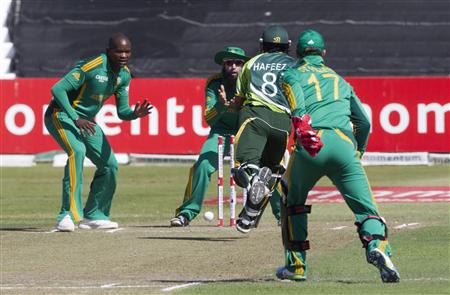 Pakistan's Muhammad Hafeez attempts to make his ground during their fourth One Day International cricket match against South Africa in Durban