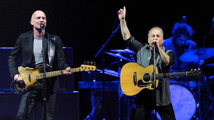 Musicians Sting, left, and Paul Simon perform together in concert at Madison Square Garden on Tuesday, March 4, 2014, in New York. (Photo by Evan Agostini/Invision/AP)