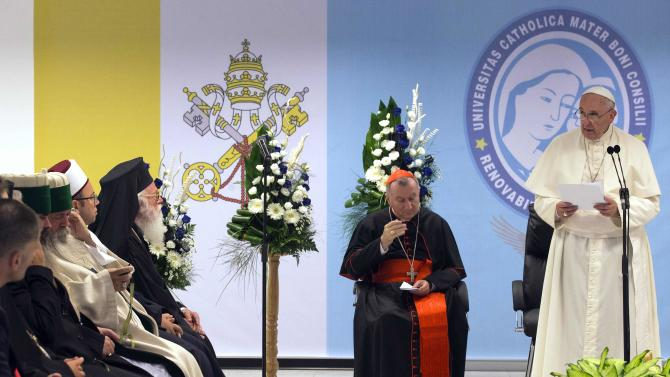 """Pope Francis speaks during a meeting with representatives of Albania's Muslim, Orthodox and Catholic communities, at the Catholic University """"Our Lady of Good Counsel"""" in Tirana"""