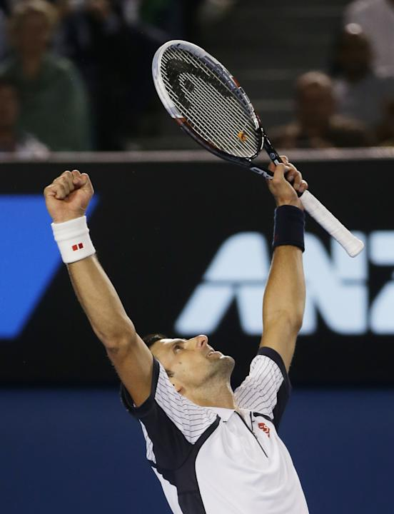Serbia's Novak Djokovic  celebrates his win over Tomas Berdych of the Czech Republic in their quarterfinal match at the Australian Open tennis championship in Melbourne, Australia, Tuesday, Jan. 22, 2