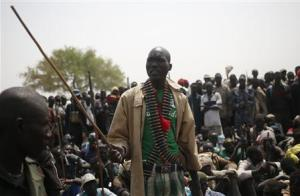 A rebel fighter talks to his comrades in a rebel-controlled territory in Upper Nile State