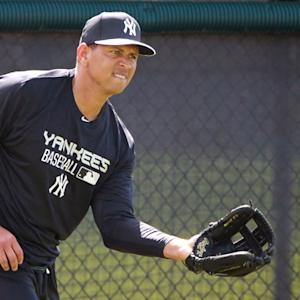 Alex Rodriguez reports to Yankees camp