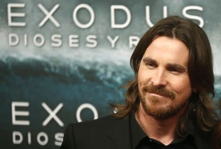 "Christian Bale poses for photographs as he arrives for the film world premiere of ""Exodus: Gods and Kings"" in Madrid"