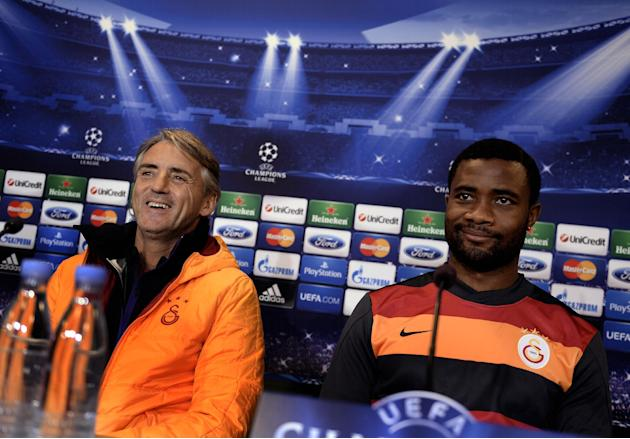 Galatasaray AS's coach, Roberto Mancini, left, and Aurelien Chedjou during a press conference prior to the Champions League soccer match against FC Copenhagen at Parken Stadium in Copenhagen, Denmark,