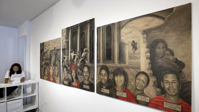 """In this July 28, 2016 photo, works from """"Black is the giant"""" by artist Dareece J. Walker are displayed at the Louis Long Gallery, in New York's Harlem neighborhood. The neighborhood already is home to about a dozen galleries. In the fall it's getting two more, transplants from Lower Manhattan. (AP Photo/Richard Drew)"""