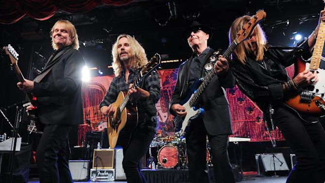 """IMAGE DISTRIBUTED FOR HARD ROCK INTERNATIONAL - From left, musicians James """"J.Y."""" Young, Tommy Shaw, Chuck Panozzo and Ricky Phillips of the band Styx, perform at Eric Clapton's Crossroads Guitar Festival artist party at The Hard Rock Cafe New York on Thursday, April 11, 2013 in New York City, New York. (Photo by Evan Agostini/Invision for Hard Rock International/AP Images)"""