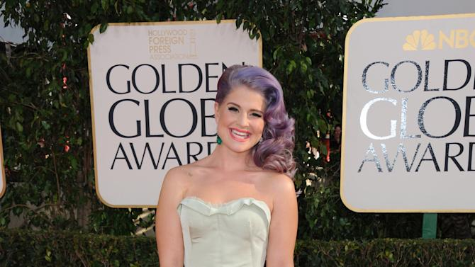 TV personality Kelly Osbourne arrives at the 70th Annual Golden Globe Awards at the Beverly Hilton Hotel on Sunday Jan. 13, 2013, in Beverly Hills, Calif. (Photo by Jordan Strauss/Invision/AP)