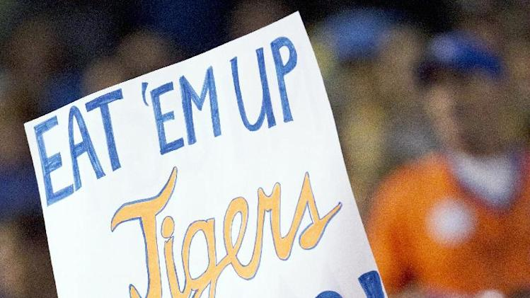 Detroit Tigers fans hold a sign during the sixth inning of a baseball game against the Kansas City Royals at Kauffman Stadium in Kansas City, Mo., Monday, Oct. 1, 2012. (AP Photo/Orlin Wagner)