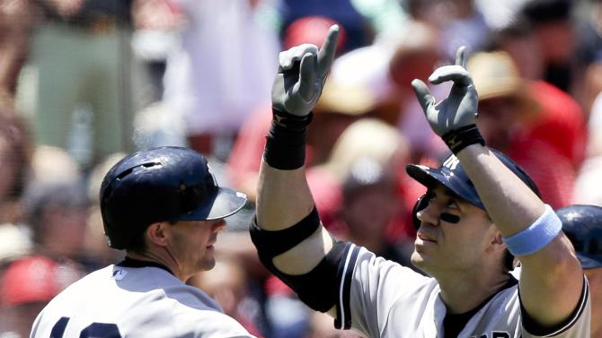 New York Yankees' Travis Hafner, right, celibates his three-run home run with teammate Chris Stewart against the Los Angeles Angels during the thirst inning of a baseball game in Anaheim, Calif., Sunday, June 16, 2013. (AP Photo/Chris Carlson)