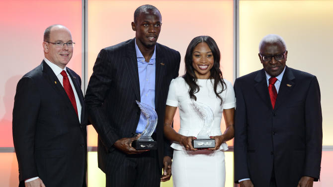From left to right: Prince Albert of Monaco, Jamaican athlete Usain Bolt, US sprinter Allyson Felix and IAAF (International Association of Athletics Federations) President Lamine Diack posefor the media during an event marking the centenary of the  IAAF (International Association of Athletics Federations), in Barcelona, Saturday, Nov. 24, 2012.  (AP Photo/Manu Fernandez)