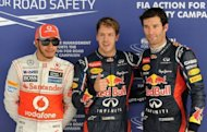 Red Bull-Renault driver Sebastian Vettel (centre), Red Bull-Renault driver Mark Webber (right) and McLaren-Mercedes driver Lewis Hamilton pose after Vettel won the pole position at the Formula One Indian Grand Prix