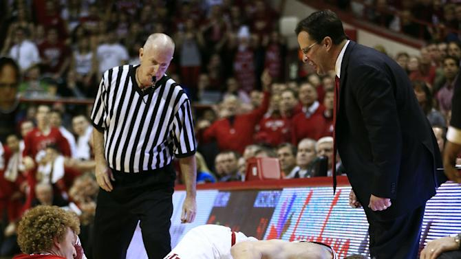 Indiana's Cody Zeller (40) and Wisconsin's Mike Bruesewitz (31) battle for a loose ball as Indiana head coach Tom Crean watches during the second half of an NCAA college basketball game, Tuesday, Jan. 15, 2013, in Bloomington, Ind. Wisconsin won 64-59. (AP Photo/Darron Cummings)