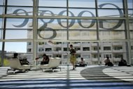 A Google logo seen through windows of Moscone Center in San Francisco last month. Google is close to reaching a deal to pay $22.5 mn to settle a suit over its secret bypassing of privacy settings of millions of Apple users, the Wall Street Journal reports