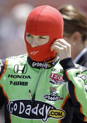 Danica Patrick prepares to put on her helmet during practice for the IndyCar Series' Iowa Corn Indy 250 auto race, Friday, June 24, 2011, at Iowa Speedway in Newton, Iowa. (AP Photo/Charlie Neibergall)