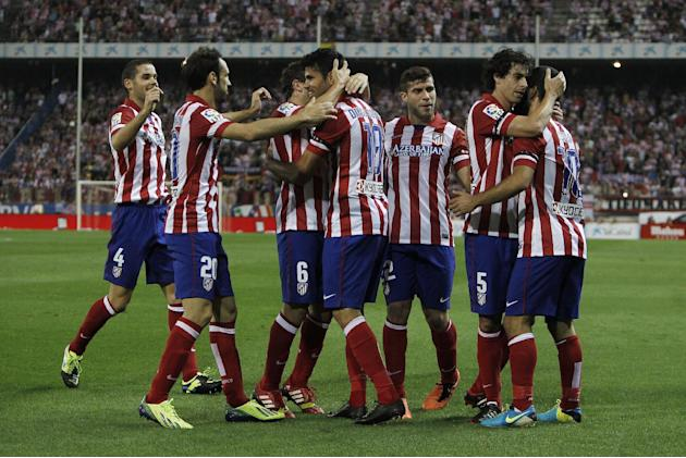 Atletico de Madrid's Diego Costa from Brazil, fourth left, celebrates his goal with team mates during a Spanish La Liga soccer match against Osasuna at the Vicente Calderon stadium in Madrid, Spain, T