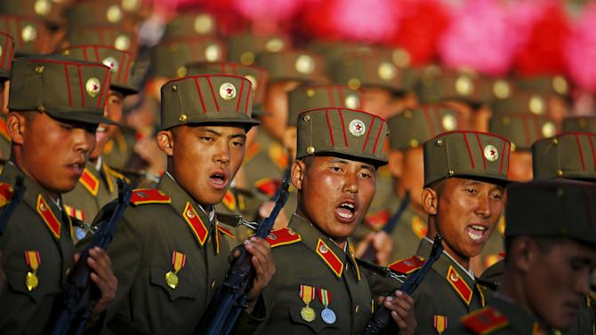 Soldiers shout as they march past a stand with North Korean leader Kim Jong Un during the parade celebrating the 70th anniversary of the founding of the ruling Workers' Party of Korea, in Pyongyang