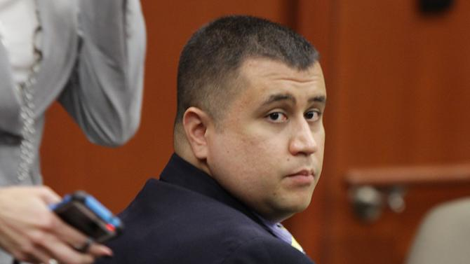 FILE - In this Oct. 19, 2012 file photo, George Zimmerman watches during his hearing at the Seminole County Courthouse in Sanford, Fla. Zimmerman sued NBC on Thursday, Dec. 6, 2012, claiming he was defamed when the network edited his 911 call to police after the shooting of Trayvon Martin to make it sound like he was racist. (AP Photo/Orlando Sentinel, Stephen M. Dowell, Pool, File)